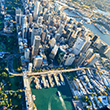A photo of Sydney city taken from the air - shows Circular Quay and Botanical Gardens and is looking towards the CBD.