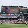 Thumbnail of cricket game at Sydney Cricket Ground showing players, the crowd and the scoreboard.